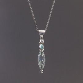 Srebrny wisior z obsydianem, perłą i larimarem