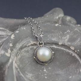 Srebrny wisior z masą perłową i złotem 18K