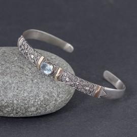 Srebrna bransoletka z błękitnym topazem i złotem 18K