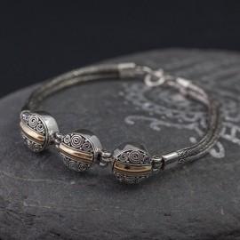 Srebrna bransoletka z elementami złota