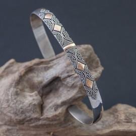 Srebrna bransoletka z elementami złota 18K