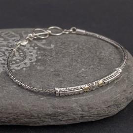 Srebrna bransoletka z odrobiną złota
