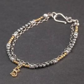 Srebrna bransoletka z hematytu z pozłacaną zawieszką
